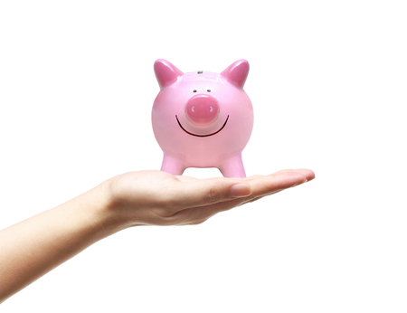 Hand holding a pink piggy bank isolated on white  Saving money concept Stock Photo