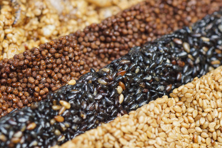 black textured background: Closeup of multigrain bars  Healthy food and snack concept Stock Photo