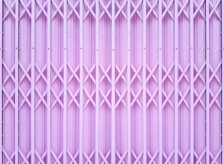 Steel foldable door background in pink color