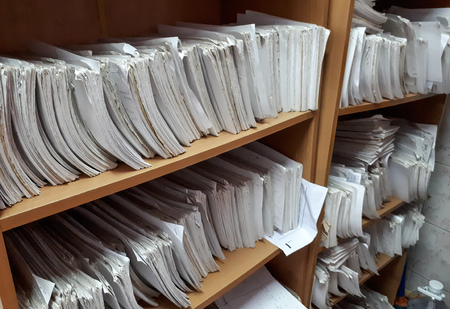 A cupboard full of paper files / inefficiency of paper based filing system 写真素材
