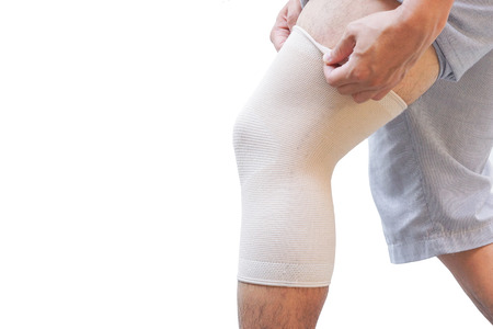 Man wearing a knee support for healing injury Stock Photo