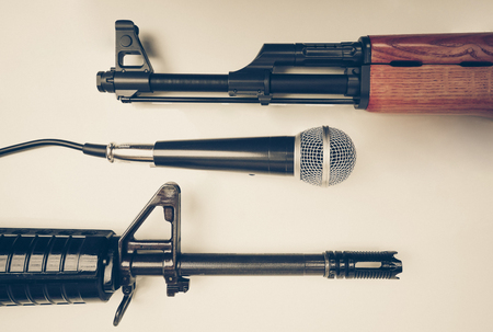 Microphone vs. Rifles  Freedom of the press is at risk concept  World press freedom day concept