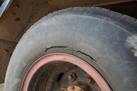 Old tire of a truck with break  Danger of using an old tire for driving concept