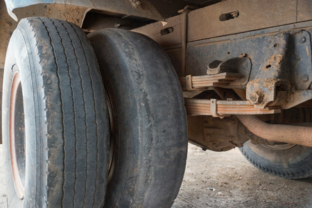 Worn out truck tire tread  Danger of using old tire with low tread depth concept Stock Photo