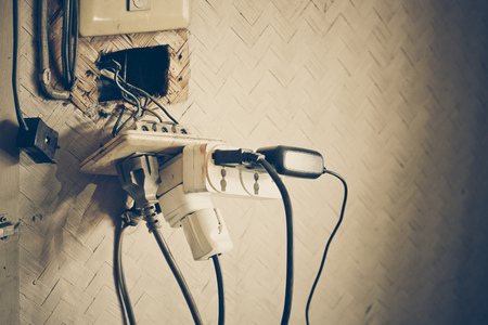 Too many plugs in a socket / Danger of using too much electricity with copy space to add text Archivio Fotografico