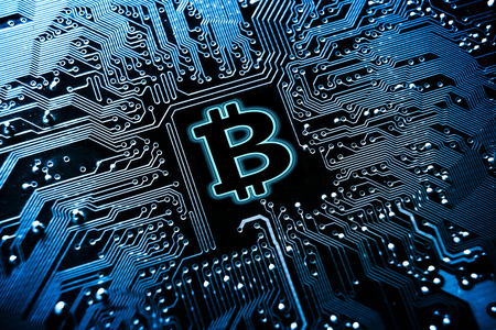 Bitcoin symbol on computer circuit board  Cryptocurrency Stok Fotoğraf