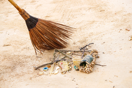 Cleaning up garbage on the beach  Environmental problem in the sea caused by human activity Stock Photo