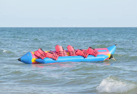 Banana boat with lifejackets on the blue sea Stock Photo