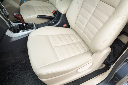 Car seats at the front row in cream color