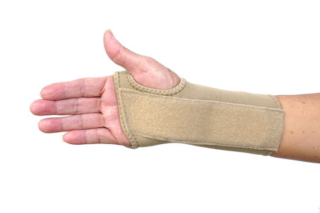 Old female hand wearing hand wrist therapy support glove isolated on white Stock Photo