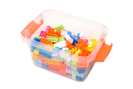 A box of colorful plastic toy blocks for kids isolated on white Stok Fotoğraf - 120028102