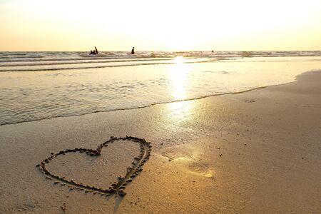 A beach with a heart written on sand Standard-Bild - 126832421
