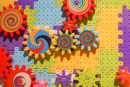 Colorful toy with connecting blocks and cogwheels Standard-Bild - 127285027