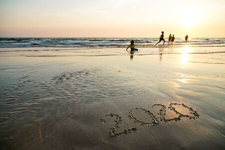 Happy New Year 2020 written on the beach Standard-Bild - 128335353