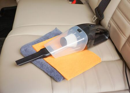 Cleaning a car using a vacuum cleaner and chamois cloth