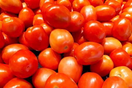 A pile of fresh red tomatoes