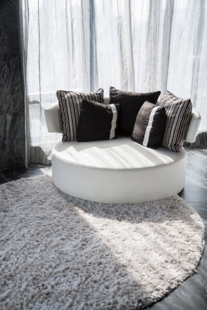 White chaise with dark backrest pillow photo