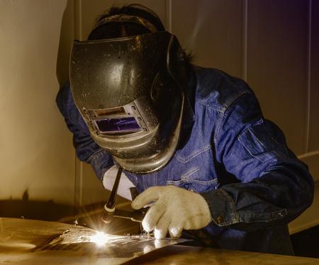 welding: Worker welding the steel part by manual Stock Photo