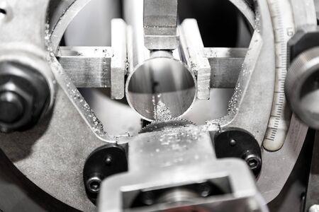 operator turning part by manual lathe machine