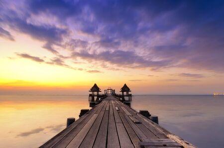 Wooden pier between sunset in Phuket, Thailand