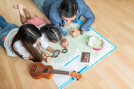 Young couple planning honeymoon vacation trip with map. Top view Фото со стока