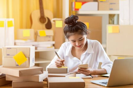 Asian teenager owner business woman work at home for online shopping and sale. Фото со стока