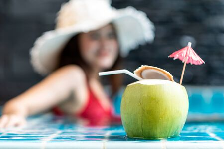 Young asian woman relaxing in swimming pool at spa resort.relaxing and spa relax concept. Фото со стока