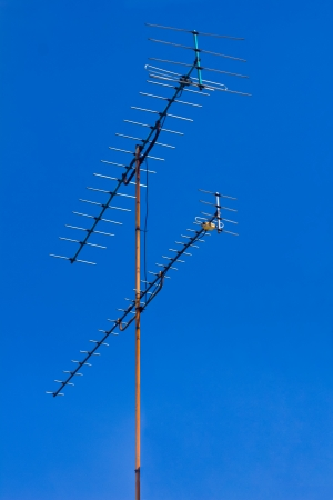 Antenna for TV in the blue sky Banco de Imagens - 23903750