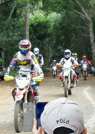 dirt bike: Was photographed driving a dirt bike on the team. Stock Photo