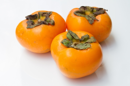 Persimmon  on a white background Stock Photo