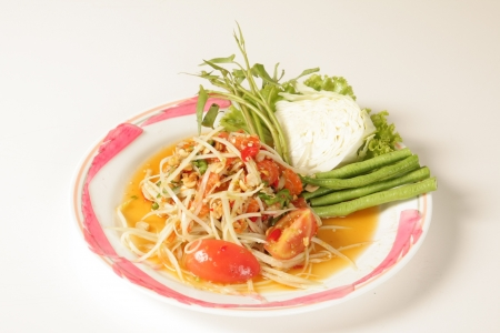 Thai papaya salad on a white background photo