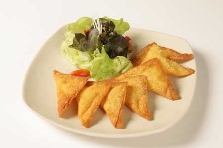 Thai fried pork dumplings on a white background Stock Photo