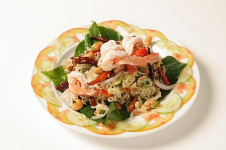Shrimp salad with Thai herbs on a white background