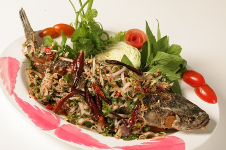 Fried fish sauce , Thai herbs on a white background