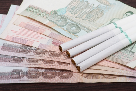 Smoking on a banknote Stock Photo