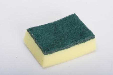 Dishwashing sponge on a white background