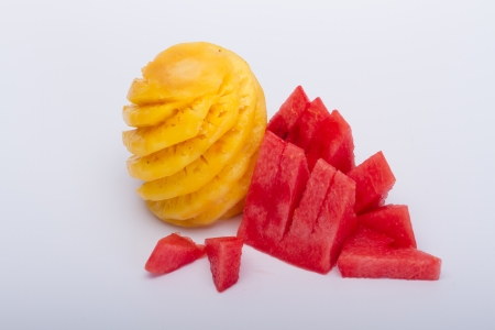 Pineapple and watermelon on a white background