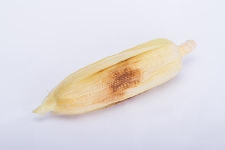 Roasting corn  on a white background