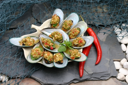Baked mussels topped with seafood sauce