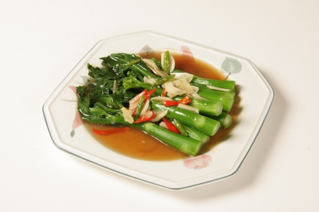 Fried kale with oyster sauce Stock Photo