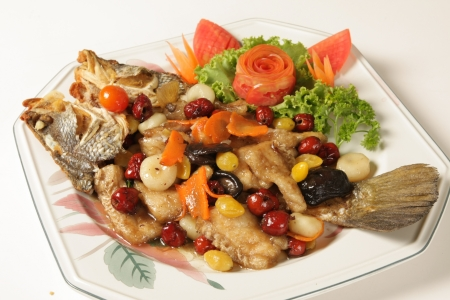 Fried red snapper topped with cereal International cuisine Stock Photo