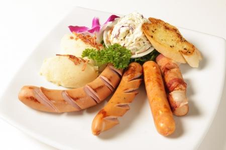 Pork sausage with garlic bread Taken on a white background