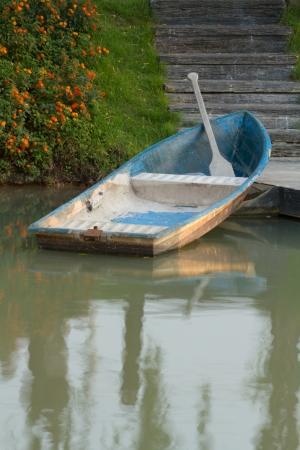 Blue rowing boat on the lake at the park Stock Photo
