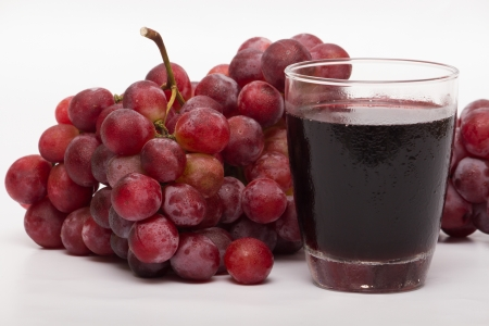 and grape juice: Red wine and grape juice Taken on a white background Stock Photo