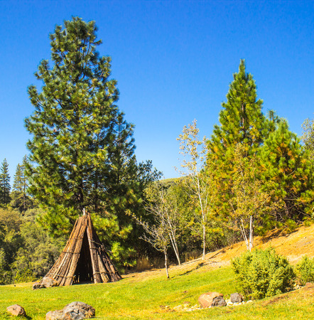 Miwuk American Indian Tepee At Base of Hill Stock Photo
