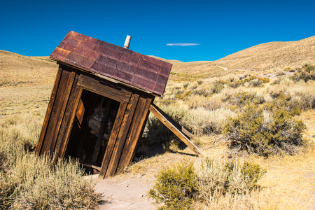 outhouse: Leaning Outhouse In California Ghost Town Stock Photo