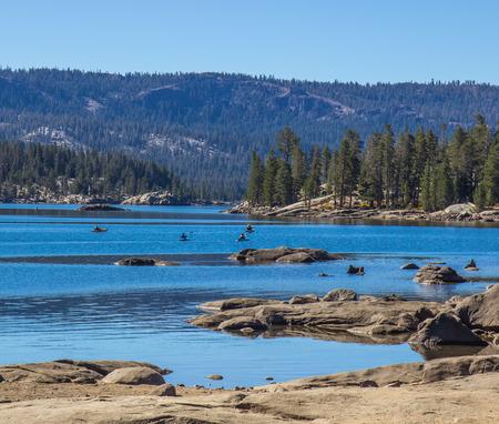 sierra nevada: Mountain Lake Shoreline With Kayaks