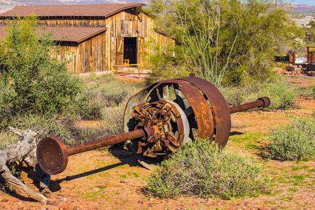 Mining Wheel & Metal Shaft In Arizona Desert