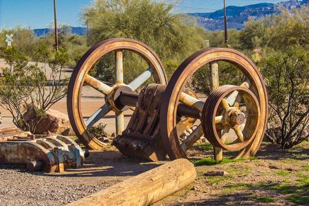 Rusted Mining Wheels In Arizona Desert