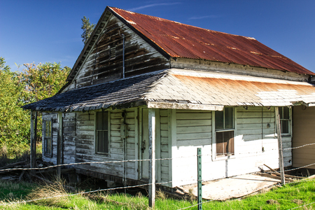 Abandoned Home With Rusty Tin Roof Stock Photo